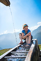 The Via Alta Verzasca is a five day ridge traverse hike above the Valle Verzasca in the Ticino region of Switzerland. Washing up in a fountain at the Capanna Cognora.