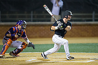 Ben Breazeale (9) of the Wake Forest Demon Deacons follows through on his swing against the Clemson Tigers at David F. Couch Ballpark on March 12, 2016 in Winston-Salem, North Carolina.  The Tigers defeated the Demon Deacons 6-5.  (Brian Westerholt/Four Seam Images)