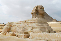 """The statue of the Great Sphinx is located at Giza Plateau, near Khafre's pyramid. The Giza plateau is near Cairo, capital of Egypt. The word """"sphinx"""" means 'strangler'. It is believed that the Khafre's workers shaped the stone into lion and gave it their king's face over 4,500 years ago. The great Sphinx is believed to be the most immense stone sculpture ever made by man."""