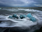 Blue ice breaks away from the iceberg in Iceland