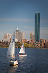 Sailboats on the Charles River in front of the Back Bay skyline and the Hancock tower by I. M. Pei in Boston, MA, USA