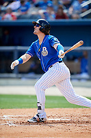 Biloxi Shuckers right fielder Clint Coulter (12) follows through on a swing during a game against the Jackson Generals on April 23, 2017 at MGM Park in Biloxi, Mississippi.  Biloxi defeated Jackson 3-2.  (Mike Janes/Four Seam Images)
