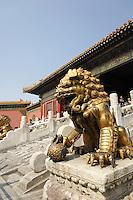 Lion guarding gate in Forbidden City, Beijing, China, Asia