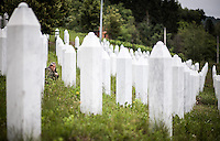 05.06.2013, Potocari ( Srebrenica ) Bosnia Herzegovina<br /> Memorial Center. <br /> Un uomo prega davanti una tomba <br /> Le oltre 7000 vittime identificate sono sepolte nel cimitero all'interno del Memorial center. <br /> L'esercito Serbo nel 1995 ha massacrato a Srebrenica circa 8.000 tra uomini e ragazzi Musulmani, la piu' grande atrocita' commessa in Europa dalla seconda guerra mondiale. <br /> Foto Insidefoto / EXPA/ Juergen Feichter