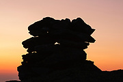 The silhouette of a rock cairn on the summit of Mount Washington at dusk in the White Mountains, New Hampshire USA