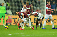 Robert Snodgrass of West Ham United tackles Ryan Babel of Fulham during West Ham United vs Fulham, Premier League Football at The London Stadium on 22nd February 2019