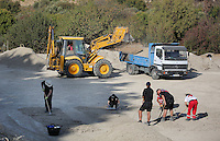 Pictured: A digger and a tipper lorry used  for the search of a field in Kos, Greece. Tuesday 04 October 2016<br /> Re: Police teams led by South Yorkshire Police, searching for missing toddler Ben Needham on the Greek island of Kos have moved to a new area in the field they are searching.<br /> Ben, from Sheffield, was 21 months old when he disappeared on 24 July 1991 during a family holiday.<br /> Digging has begun at a new site after a fresh line of inquiry suggested he could have been crushed by a digger.