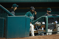 Greensboro Grasshoppers manager Kieran Mattison (center) looks on from the dugout during the game against the \kc\ at First National Bank Field on May 6, 2021 in Greensboro, North Carolina. (Brian Westerholt/Four Seam Images)