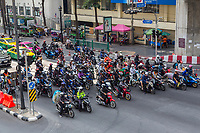 Bangkok, Thailand.  Motorcycles at Intersection by the Erawan Shrine.