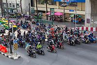 Bangkok, Thailand.  Motorcycles at Intersection by the Erawan Shrine.