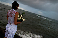 A Candomblé faithful throws flowers in the sea during the celebration of Yemanjá, the goddess of the sea, in Salvador, Bahia, Brazil, 2 February 2012. Yemanjá, originally from the ancient Yoruba mythology, is one of the most popular ?orixás?, the deities from the Afro-Brazilian religion of Candomblé. Every year on February 2nd, thousands of Yemanjá devotees participate in a colorful celebration in her honor. Faithful, usually dressed in the traditional white, gather on the beach at dawn to leave offerings for their goddess. Gifts for Yemanjá include flowers, perfumes or jewelry. Dancing in the circle and singing ancestral Yoruba prayers, sometimes the followers enter into a trance and become possessed by the spirits. Although Yemanjá is widely worshipped throughout Latin America, including south of Brazil, Uruguay, Cuba or Haiti, the most popular cult is maintained in Bahia, Brazil.