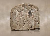 Ancient Egyptian stele depicting Sethy I adoring Amenhotep I and Nefertari, limestone, New Kingdom, 19th Dynasty, (1279-1213 BC), Deir el-Medina,  Egyptian Museum, Turin.  Schiaparelli Cat 6189.