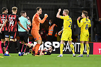 Asmir Begovic of AFC Bournemouth and Jack Grimmer of Wycombe Wanderers argue after a tackle by Alex Pattison of Wycombe Wanderers right who was sent off during AFC Bournemouth vs Wycombe Wanderers, Sky Bet EFL Championship Football at the Vitality Stadium on 15th December 2020