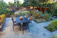 Small space back yard flagstone dining patio, Lundstrom Garden, design by Susan Morrison