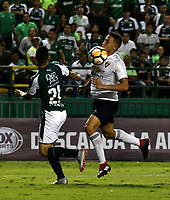 PALMIRA - COLOMBIA, 19-09-2018: Nicolás Benedetti (Izq.) jugador de Deportivo Cali disputa el balón con Franklin Guerra (Der.) jugador de Liga Deportiva Universitaria de Quito, durante partido entre Deportivo Cali (COL) y Liga Deportiva Universitaria de Quito (ECU), de los octavos de final, llave H, por la Copa Conmebol Sudamericana 2018, jugado en el estadio Deportivo Cali (Palmaseca) en la ciudad de Palmira. / Nicolás Benedetti (L) player of Deportivo Cali vies for the ball with Franklin Guerra (R) player of Liga Deportiva Universitaria de Quito, during a match between Deportivo Cali (COL) and Liga Deportiva Universitaria de Quito (ECU), of eighth finals, key H, for the Copa Conmebol Sudamericana 2018, at the Deportivo Cali (Palmaseca) stadium in Palmira city. Photo: VizzorImage  / Luis Ramirez / Staff.