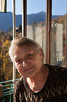 Switzerland. Canton Ticino. Sala. Elsy (Elsa) Hofer Ferrrai Ramuz is 86 years old. She stands on the balcony of her home.  Elsy Hofer Ferrai Ramuz is the niece of Charles-Ferdinand Ramuz (September 24, 1878 – May 23, 1947) who was a French-speaking Swiss writer. Elsy Hofer Ferrari Ramuz is the niece of Charles-Ferdinand Ramuz (September 24, 1878 – May 23, 1947) who was a French-speaking Swiss writer.  14.11.2017 © 2017 Didier Ruef