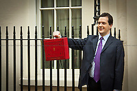 """George Osborne, Chancellor of the Exchequer - 2011<br /> <br /> London, 23/03/2011. UK Prime Minister David Cameron leaves 10 Downing Street on Budget Day. He is followed by  the Chancellor of the Exchequer, George Osborne, who (followed by his team) shows the """"red box"""" (Budget Box) containing the Budget for the fiscal year. In the meanwhile, outside the gates of Downing Street, protesters gather for a variety of demonstrations. The demands of protestors included an end to the Government budget cuts and austerity measures and a stop to cuts in the NHS."""