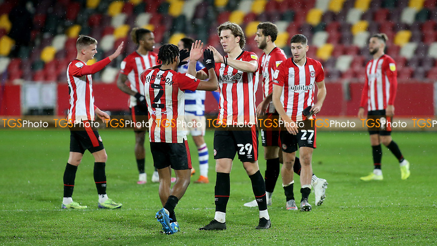 Dominic Thompson and Mads Bech Sorensen of Brentford celebrate their victory at the final whistle during Brentford vs Reading, Sky Bet EFL Championship Football at the Brentford Community Stadium on 19th December 2020