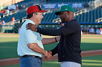 Hall of Fame Catcher Johnny Bench (left) greets Ricky Gutierrez before a Florida State League game between the Daytona Tortugas and Palm Beach Cardinals on April 11, 2019 at Roger Dean Stadium in Jupiter, Florida.  Palm Beach defeated Daytona 6-0.  (Mike Janes/Four Seam Images)