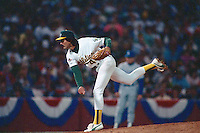 OAKLAND, CA - Dennis Eckersley of the Oakland Athletics pitches against the Los Angeles Dodgers in Game 4 of the 1988 World Series at the Oakland Coliseum in Oakland, California in 1988. Photo by Brad Mangin