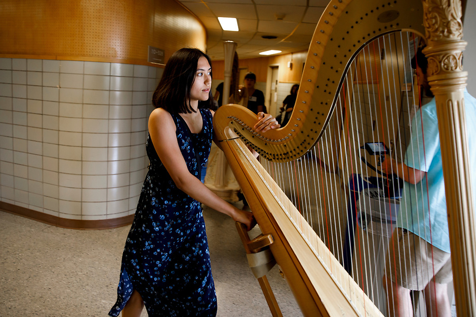 Volunteers move harps from practice rooms during the 11th USA International Harp Competition at Indiana University in Bloomington, Indiana on Wednesday, July 3, 2019. (Photo by James Brosher)