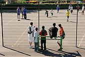 Queens Park Rangers community outreach team run a  football training session in Queens Park Gardens, a Westminster City Council park.