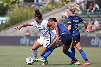 CARY, NC - SEPTEMBER 12: Sophia Smith #9 of the Portland Thorns FC and Abby Erceg #6 of the North Carolina Courage challenge for the ball during a game between Portland Thorns FC and North Carolina Courage at Sahlen's Stadium at WakeMed Soccer Park on September 12, 2021 in Cary, North Carolina.