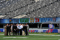 FIFA delegates inpect the pitch during a tour of the New Meadowlands Stadium by the FIFA World Cup Inspection Delegation in East Rutherford, NJ, on September 07, 2010.