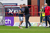 25th September 2021; Dens Park, Dundee, Scotland: Scottish Premiership football, Dundee versus Rangers; Dundee manager James McPake with Leigh Griffiths after the striker goes off injured