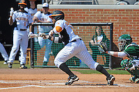 Khayyan Norfork #8 of the Tennessee Volunteers squares to bunt at Lindsey Nelson Stadium against the the Manhattan Jaspers on March 12, 2011 in Knoxville, Tennessee.  Tennessee won the first game of the double header 11-5.  Photo by Tony Farlow / Four Seam Images..
