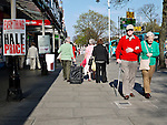 An elderley couple stroll along Lord Street Southport England in the March sunshine.