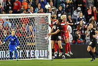 USWNT forward Abby Wambach (20) attempts to head a cross.