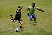 COLUMBUS, OH - DECEMBER 12: Lucas Zelarayan #10 of Columbus Crew kicks the ball while defended by Yeimar Gomez Andrade #28 of Seattle Sounders FC during a game between Seattle Sounders FC and Columbus Crew at MAPFRE Stadium on December 12, 2020 in Columbus, Ohio.