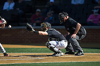 Wake Forest Demon Deacons catcher Ben Breazeale (9) reaches for a pitch as home plate umpire John Haggerty looks on during the game against the Florida State Seminoles at David F. Couch Ballpark on April 16, 2016 in Winston-Salem, North Carolina.  The Seminoles defeated the Demon Deacons 13-8.  (Brian Westerholt/Four Seam Images)