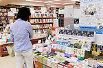 A woman looks at the Haruki Murakami's new book ''Novelist as a Vocation'' at Kinokuniya bookshop in Shinjuku on September 10, 2015, Tokyo, Japan. According to the Asahi Shimbun, the bookshop chain acquired 90,000 copies of the 100,000-copy first print run to sell directly via its 66 stores throughout the country, and distribute to other shops around Japan through wholesalers. One of the major Japanese bookshop chains, Kinokuniya is taking a stand against the increasing dominance of big online retailers such as Amazon by restricting their access to the first print run of a new book release. Published by Switch, and already number five on Amazon.co.jp's bestseller charts, ''Novelist As a Vocation'' collects essays Murakami wrote for the literary magazine Monkey about life as a writer, with an extra 150 pages of new content. (Photo by Rodrigo Reyes Marin/AFLO)