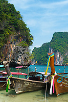 Traditional Thai longtail boats on the beach in Koh Lao La Ding island