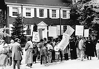 Pickets at Premier's house: About 200 angry placard-waving parents and pupils from about a dozen public school picketed in front of Ontario's Premier David Peterson's home in Forest Hill today to protest the teachers' strike. They had hoped to confront Peterson on his way to work; but he had been forewarned and left earlier than usual; said organizers of the morning protest.<br /> <br /> Photo : Boris Spremo - Toronto Star archives - AQP
