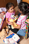 Education preschool 3-4 year olds two girls talking and playing in pretend play area
