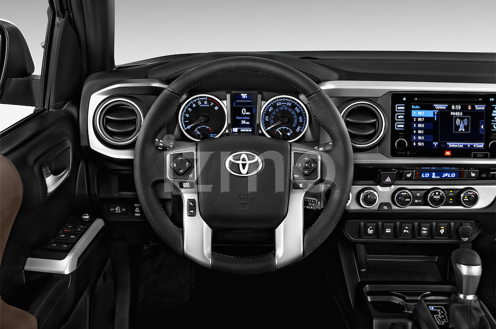 Car pictures of steering wheel view of a 2016 Toyota Tacoma Limited 4 Door Pickup Steering Wheel