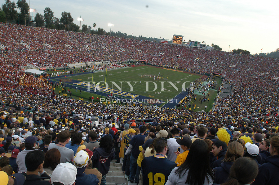 Michigan fans watch in frustration during the Wolverines' 14-28 loss to USC on Thursday, January 1, 2004 at the Rose Bowl in Pasadena, California. It was Michigan's 18th appearance at the Rose Bowl and the 90th game the bowl has played. (TONY DING/The Michigan Daily)