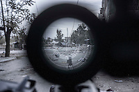 In this Friday, Nov. 02, 2012 photo, a sniper line of fire is seen through a telescope of a machine gun in the nearby Karmal Jabl battlefield in Aleppo, the Syrian's largest city. (AP Photo/Narciso Contreras).