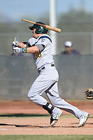 Oakland Athletics third baseman Ryon Healy (30) breaks his bat during an Instructional League game against the Milwaukee Brewers on October 10, 2013 at Maryvale Baseball Park Training Complex in Phoenix, Arizona.  (Mike Janes/Four Seam Images)