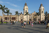 Peru, Lima.  Cathedral on right, Archbishop's Palace on left.  Plaza de Armas.