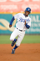 Julio Aparicio (23) of the Burlington Royals hustles into third base with a triple at Burlington Athletic Park in Burlington, NC, Wednesday, August 13, 2008. (Photo by Brian Westerholt / Four Seam Images)