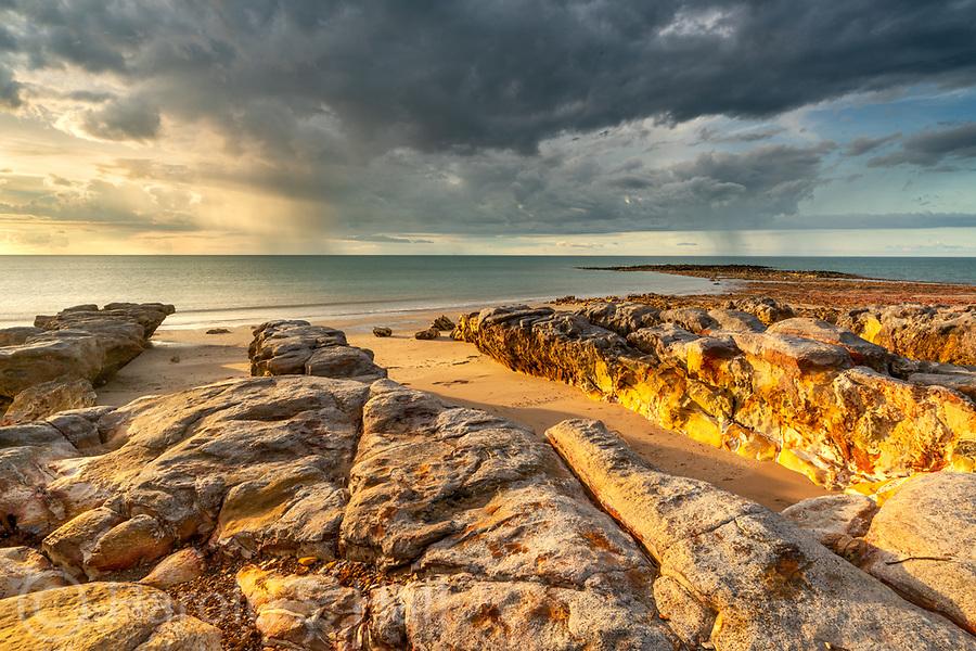 Rocky Darwin Beach at Sunset