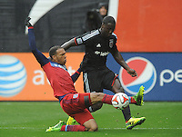 Washington D.C. - March 29, 2014:  Matt Watson of the Chicago Fire defends the ball against Eddie Johnson (7) of D.C. United. The Chicago Fire tied D.C. United 2-2 during a Major League Soccer match for the 2014 season at RFK Stadium.