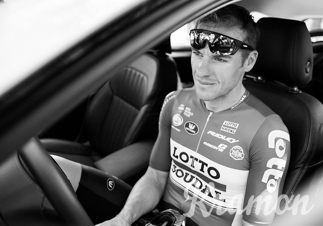 a relaxed Adam Hansen (AUS/Lotto-Soudal) in the teamcar at the stage start in the tiny birth town of Fausto Coppi: Castellania as team buses weren't allowed up<br /> <br /> 100th Giro d'Italia 2017<br /> Stage 14: Castellania › Oropa (131km)