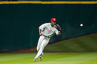 Philadelphia Phillies outfielder John Mayberry #15 tracks a ball during the Major League baseball game against the Houston Astros on September 16th, 2012 at Minute Maid Park in Houston, Texas. The Astros defeated the Phillies 7-6. (Andrew Woolley/Four Seam Images).