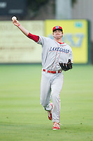 Zach Green (12) of the Lakewood BlueClaws warms up in the outfield prior to the game against the Kannapolis Intimidators at CMC-NorthEast Stadium on July 19, 2014 in Kannapolis, North Carolina.  The Intimidators defeated the BlueClaws 8-4. (Brian Westerholt/Four Seam Images)