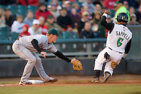 Third baseman Anthony Hatch #11 of the Great Lakes Loons puts the tag on Dave Sappelt #6 of the Dayton Dragons as he tries to steal third base at Fifth Third Field April 22, 2009 in Dayton, Ohio. (Photo by Brian Westerholt / Four Seam Images)